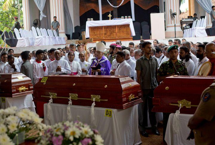 Cardinal Malcolm Ranjith speaks during a funeral service for victims at St. Sebastian's Church in Negombo, Sri Lanka, on Apri