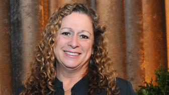 Abigail Disney poses with her award at the 34th annual Muse Awards presented by New York Women in Film & Television (NYWIFT), Thursday, Dec. 11, 2014, in New York. The Muse Awards recognize the outstanding vision and achievement of women in film, television and digital media industries.(Photo by Diane Bondareff/Invision for New York Women in Film & Television/AP Images)