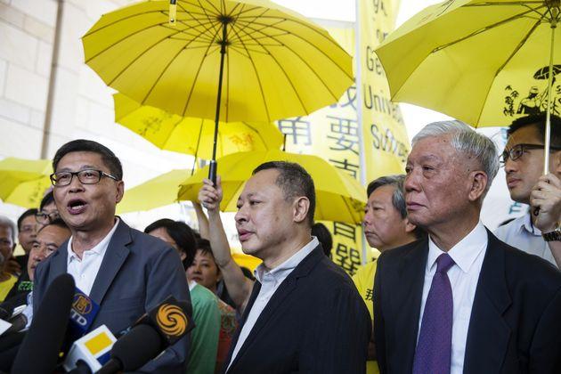 Chan Kin-man, cofondateur du groupe de militants Occupy Central, Benny Tai, professeur agrégé...