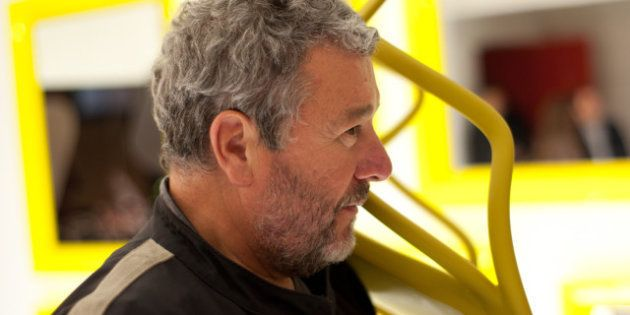description 1 Philippe Starck, Designer holding a Kartell's Chair | date 2011-11-16 | source http://www....
