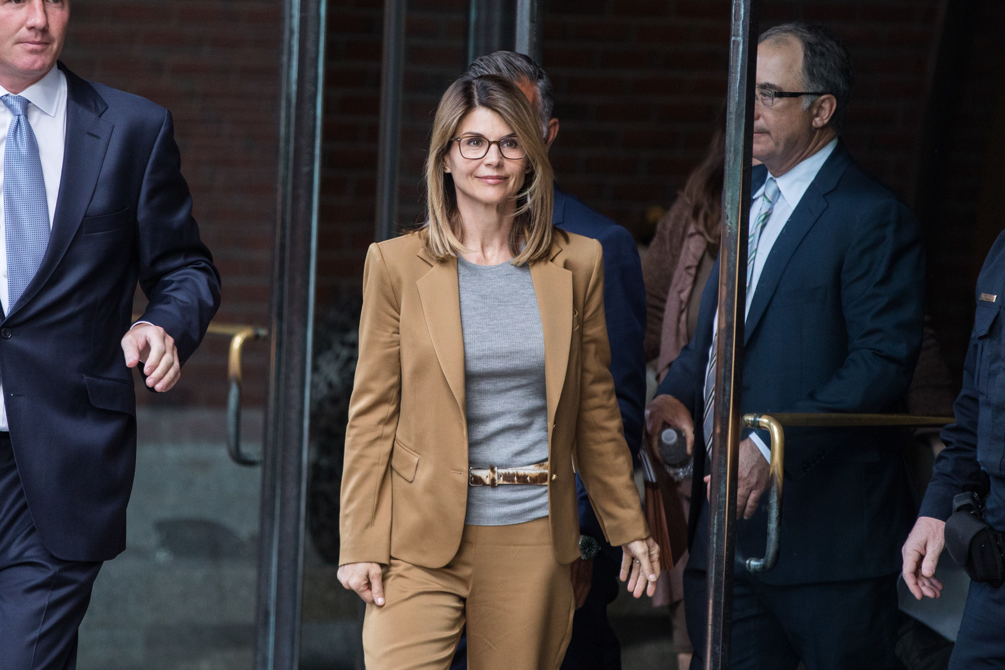 Actress Lori Loughlin exits federal court in Boston on April 3.