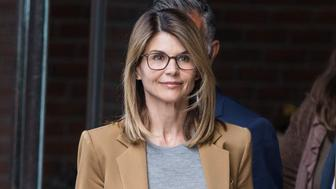 Actress Lori Loughlin, center, exits federal court in Boston, Massachusetts, U.S., on Wednesday, April 3, 2019. Wealthy parents appeared in court as the clock ticks down on plea bargains for their alleged role in the biggest college admissions scam the Justice Department has ever prosecuted. Photographer: Scott Eisen/Bloomberg via Getty Images