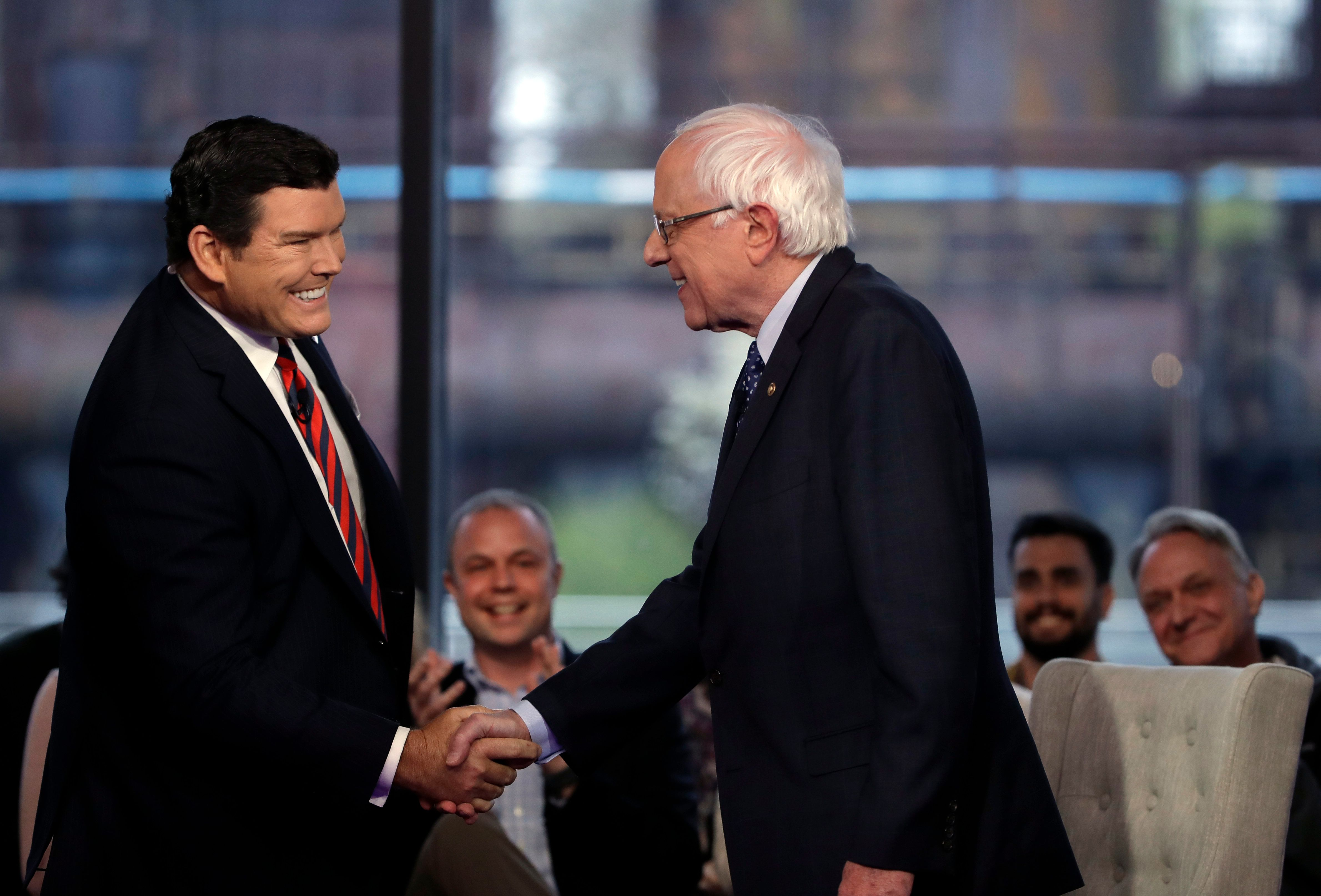 Sen. Bernie Sanders shakes hands with Bret Baier during a Fox News town-hall style event Monday April 15, 2019 in Bethlehem, Pa. (AP Photo/Matt Rourke)