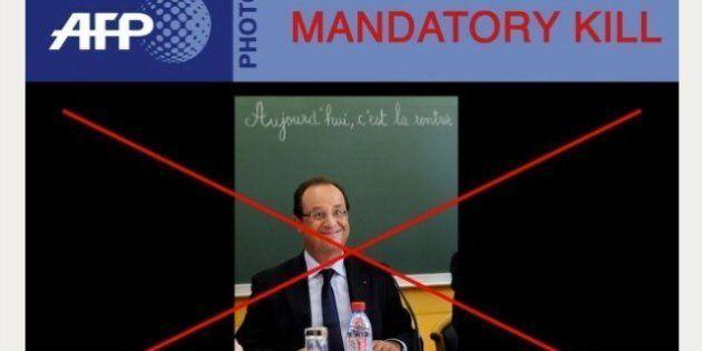 François Hollande viene male in foto. E l'AFP la