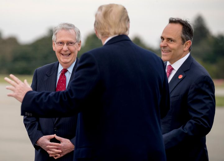 Sen. Mitch McConnell (left) and Bevin greet President Donald Trump in Lexington on Oct. 13, 2018, ahead of a rally nearby.