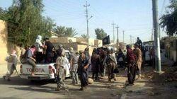 Jihadisti Isil marciano verso