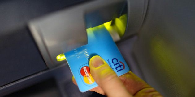 A Mastercard Inc. logo sits on a Citi banking card placed in an automated teller machine (ATM) inside...