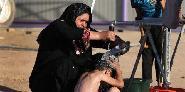 Iraq, miliziani Isis a caccia di nubili nelle zone conquistate. Kerry incontra il premier