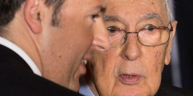 Italian President Giorgio Napolitano, right, listens to just-sworn in Italian Premier Matteo Renzi at...