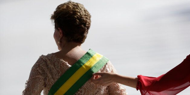 Brazil's President Dilma Rousseff gets the presidential sash adjusted by her daughter Paula  after being sworn in for a secon