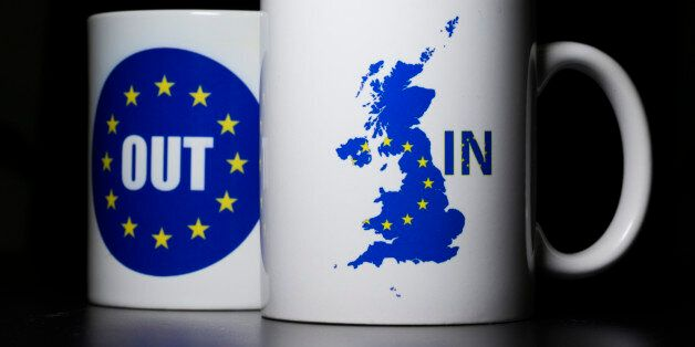 LONDON, UNITED KINGDOM - MARCH 17:  In this photo illustration, the words 'IN' and 'OUT' are depicted on mugs on March 17, 20