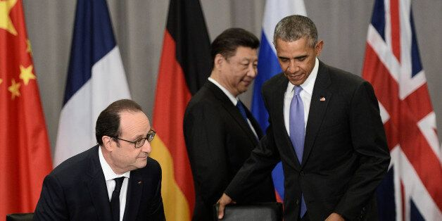 French President Francois Hollande (L), China's President Xi Jinping (C) and US President Barack Obama (R) arrive to take part in a P5+1 meeting during the Nuclear Security Summit at the Walter E. Washington Convention Center on April 1, 2016 in Washington, DC. / AFP / STEPHANE DE SAKUTIN (Photo credit should read STEPHANE DE SAKUTIN/AFP/Getty Images)