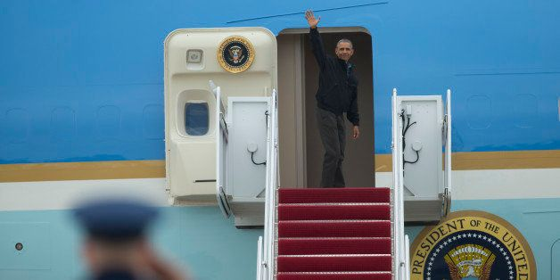 President Barack Obama waves as he boards Air Force One, Saturday, May 21, 2016, at Andrews Air Force...