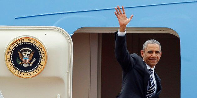 US President Barack Obama waves as he boards Air Force One upon his departure from Noi Bai international airport in Hanoi on