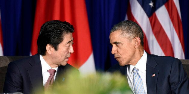 U.S. President Barack Obama, right, and Japan's Prime Minister Shinzo Abe, left, talk during a bilateral meeting at the Asi