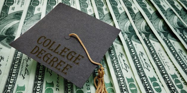 College Degree graduation cap on assorted hundred dollar bills