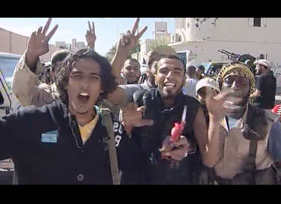 Libyan fighters celebrate in the streets of Sirte, Libya in this image taken from TV Thursday Oct. 20, 2011. The Libyan fight