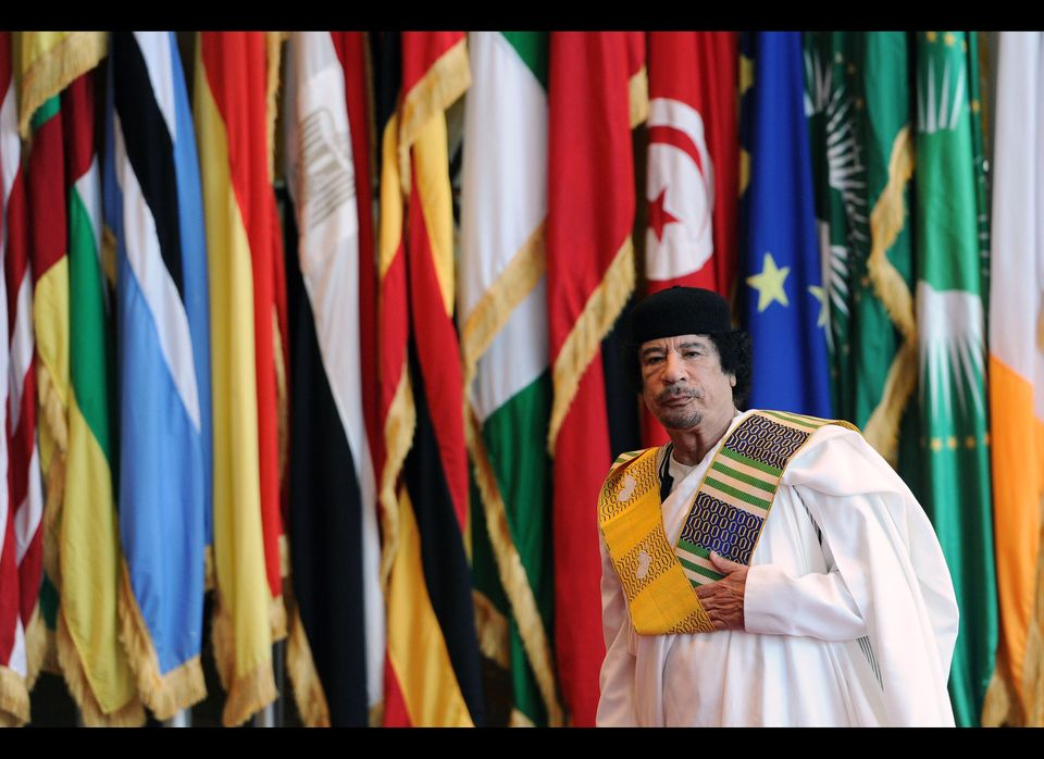 """On every foreign trip he makes, Gadhafi is <a href=""""http://www.thefirstpost.co.uk/52723,news-comment,news-politics,ten-facts-"""