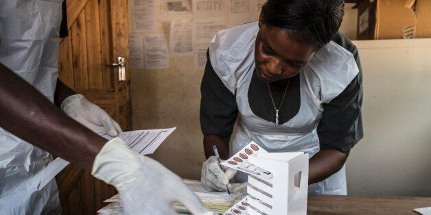 Lab technician Mathias Semba (L), 27, organizes blood samples at the Tengani health center in the Nsanje district of southern