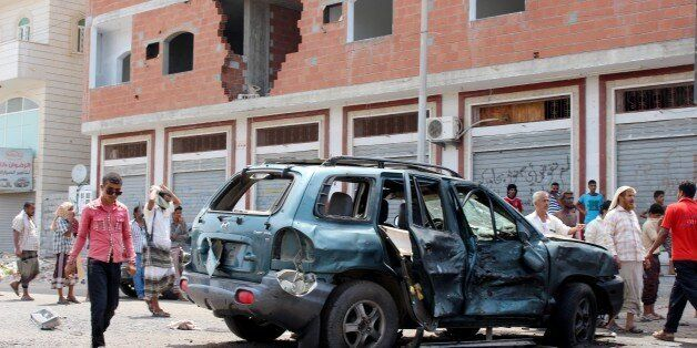 ADEN, YEMEN - MAY 23: Yemeni people inspect an incident area after a car bomb attack in Aden, Yemen on May 23, 2016. At least