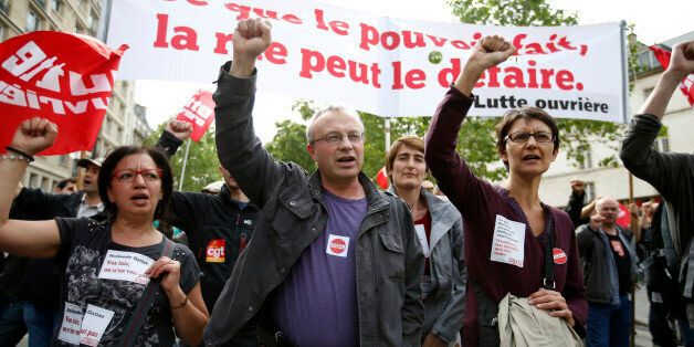 French labour union members march during a demonstration in protest of the government's proposed labour law reforms in Paris,