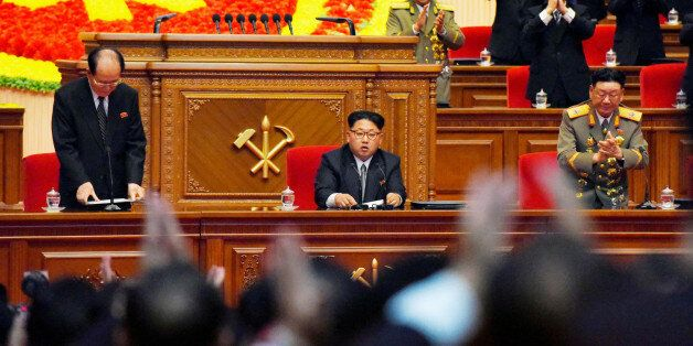 North Korean leader Kim Jong Un (C) receives applause from participants at the first congress of the country's ruling Workers