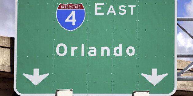 'Highway Sign pointing to Orlando, FL.  Home of several family entertainment sites like Disney World, Universal Studios and S
