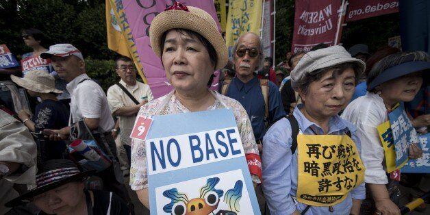 TOKYO, JAPAN - JUNE 19: Anti-U.S. airbase demonstrators protest the U.S. Airbase relocation to Henoko in front of the Japanes