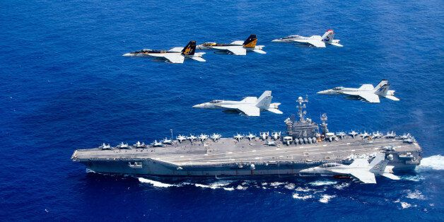 PHILIPPINE SEA - JUNE 18:  In this handout provided by the U.S. Navy, a combined formation of aircraft from Carrier Air Wing