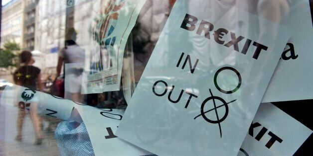 A poster featuring a Brexit vote ballot with 'out' tagged is on display at a book shop window in Berlin on June 24, 2016.