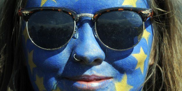 A festival-goer with a European flag painted on her face poses for a photograph on day three of the Glastonbury Festival of M