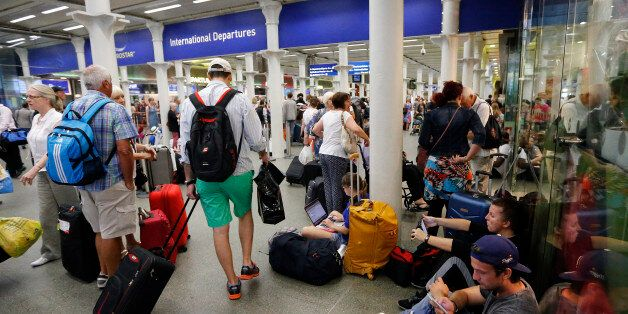 People queue as they wait at the St. Pancras international train station terminal in London, Thursday, July 2, 2015. French p