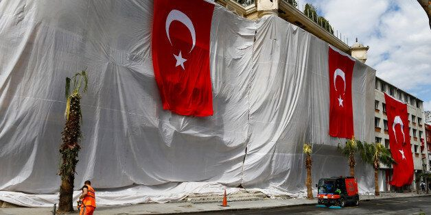 Buildings are seen covered and decorated with Turkish flags after Tuesday's car bomb attack on a police bus, in Istanbul, Tur