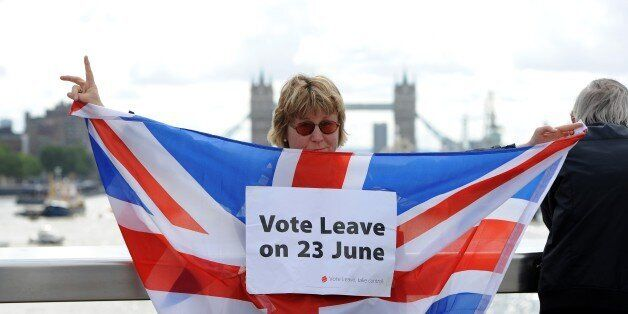 LONDON, UNITED KINGDOM - JUNE 15: A leave supporter is seen as fishing boats campaigning for Brexit sail down the Thames thro