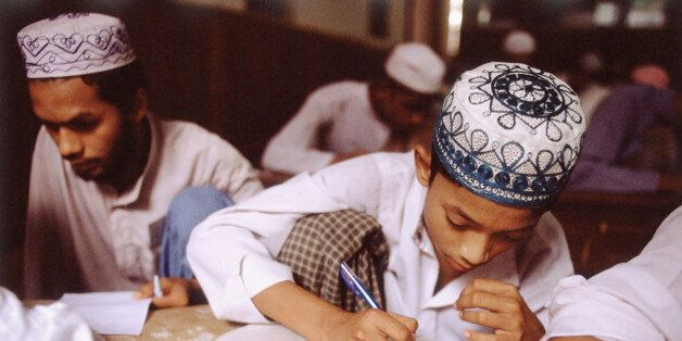 Myanmar (Burma), Yangon (Rangoon), Muslim students studying in school.