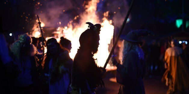 Revellers dance around a fire as they take part in Walpurgis Night (Walpurgisnacht) celebrations at the film park in Babelsbe