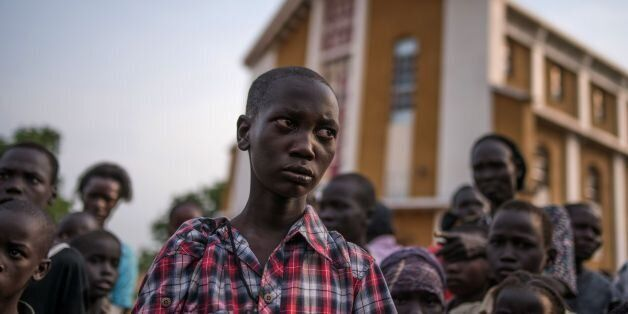 TOPSHOT - Steven, a young orphaned boy from the recent fighting in Juba who has lost his family from the fighting in Munuki s