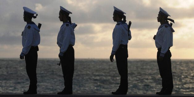 Vietnamese naval soldiers stand as they patrol at Truong Sa Dong island in the Spratly archipelago January 7, 2013. A group o