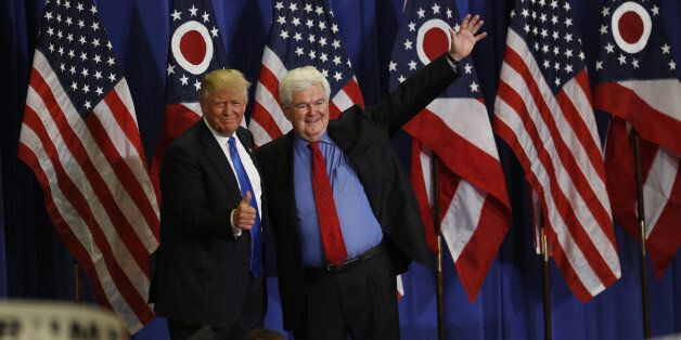 Donald Trump, presumptive Republican presidential nominee, left, stands on stage with Newt Gingrich, former speaker of the U.
