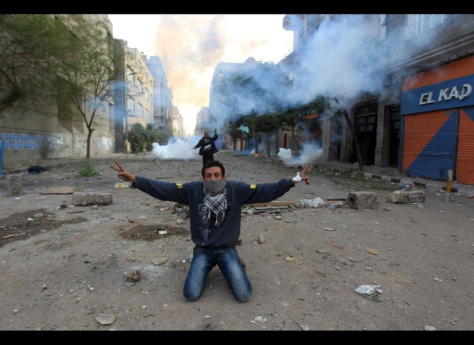 An Egyptian protester shows the V-sign for victory during clashes with riot police at Cairo's landmark Tahrir Square on Novem