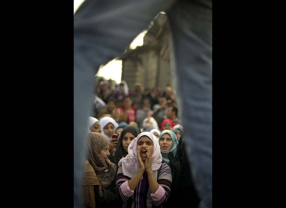 An Egyptian woman shouts slogans during a demonstration in Cairo's Tahrir Square on November 24, 2011 as Egypt's military rul