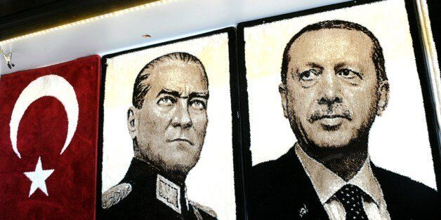 Embroidered images of the founder of modern Turkey Mustafa Kemal Ataturk (L) and Turkey's Prime Minister Recep Tayyip Erdogan
