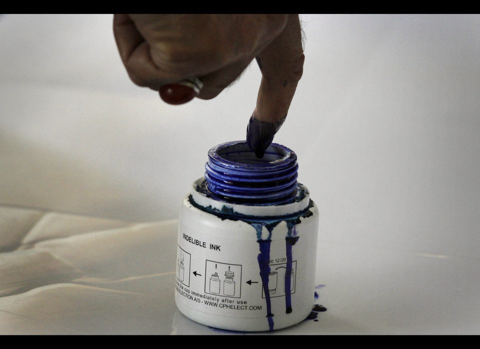 A man dips his finger into an ink bottle before casting his vote during the Afghan parliamentary election in Kabul in 2010. T