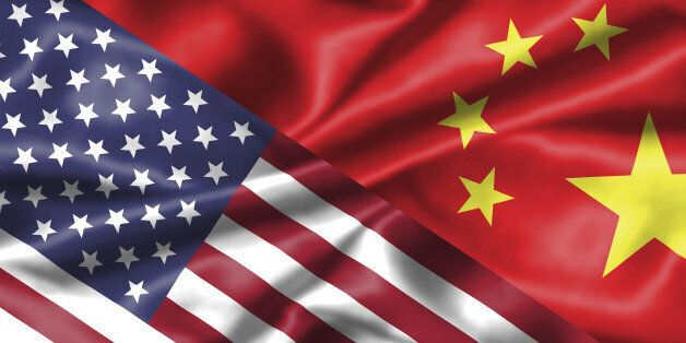 China and America : two national flags face to face, symbol for the relationship between the two countries.