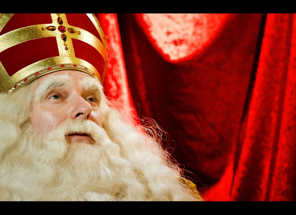 The performer playing Sinterklaas looks on as the Sinterklaas  procession arrives in Dordrecht on November 13, 2011.  (Getty)