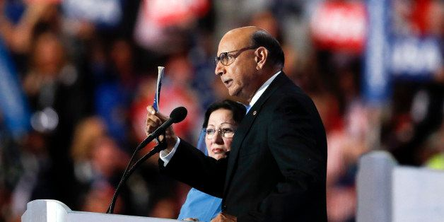 Khizr Khan, father of fallen US Army Capt. Humayun S. M. Khan, holds up his copy the United States Constitution, while his wi
