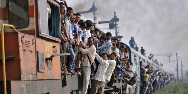 8 luglio 2014, fotonotizie dal mondo. L'inferno dei treni in India, il governo promette rivoluzione da...