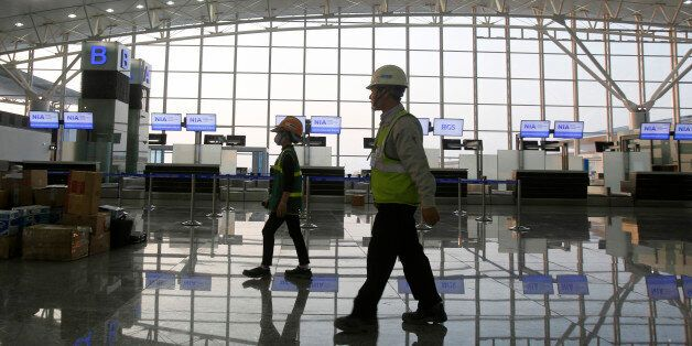 Workers leave the new terminal two wing at Noi Bai international airport in Hanoi December 20, 2014. Vietnam has started oper