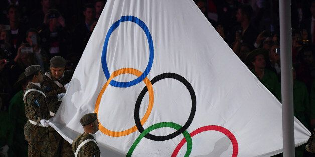 The Olympic flag is raised during the opening ceremony of the Rio 2016 Olympic Games at the Maracana stadium in Rio de Janeir