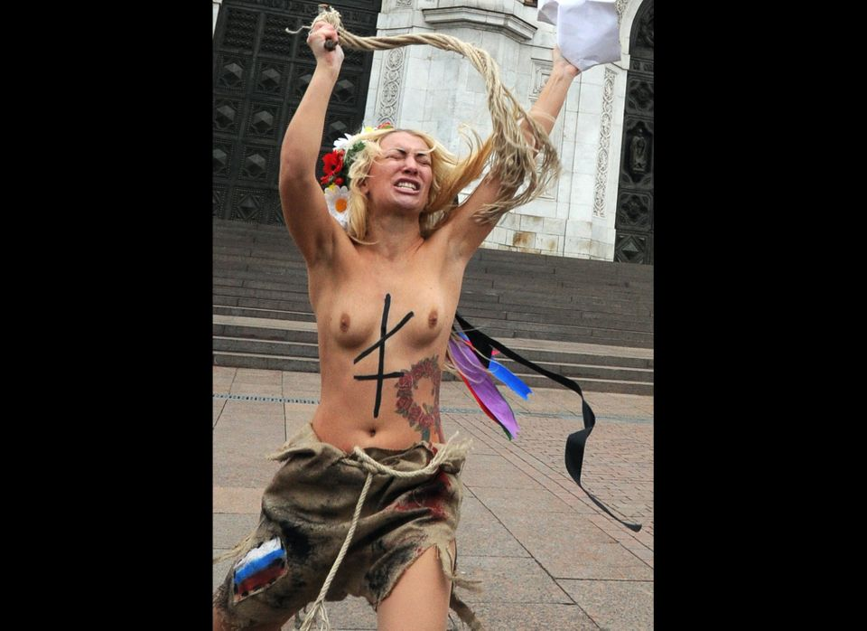 One of the activists of the Ukrainian women's movement FEMEN takes part in a stage performance in front of the Christ the Sav